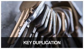 Image of a dozen keys on a keychain